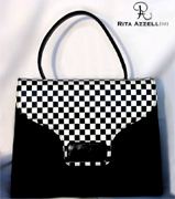 Rita Azzellini Is An Italian Handbags Designer And Manufacturing Industry Based In Rome We